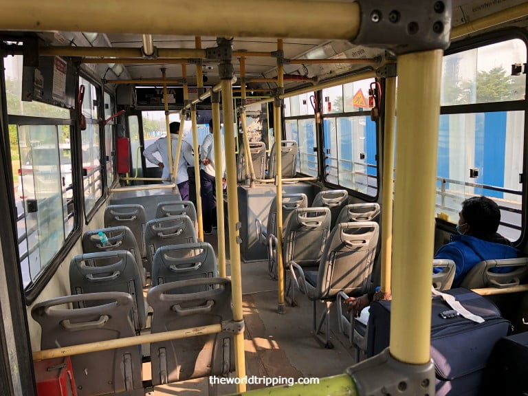 City bus to drop off passengers for hotel quarantine
